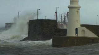 Waves crashing at harbour