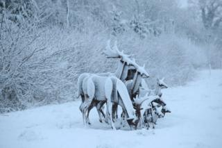 Reindeer sculptures covered in snow