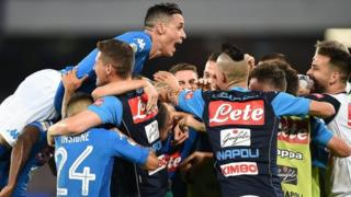 Napoli's players celebrate scoring in a Serie A game