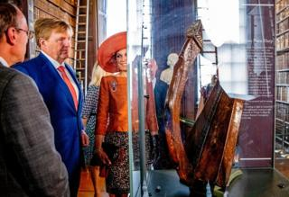 King Willem-Alexander and Queen Maxima of The Netherlands look at an artefact in the Long Room Library in Trinity College Dublin, Ireland
