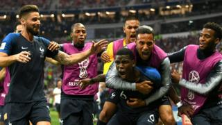 France's Paul Pogba celebrates with teammates after scoring the third of France's four goals