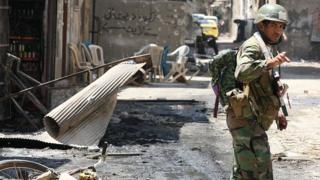 عکس آرشیوی از سرباز دولت سوریه در دمشق