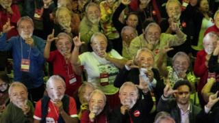 Many delegates at the convention wore Lula facemasks