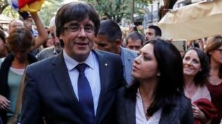 Sacked Catalan President Carles Puigdemont walks with his wife Marcela Topor during a walkabout in Girona, October 28, 2017