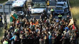 Protesters block the C-31 road during a strike in L'Hospitalet, Barcelona
