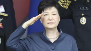South Korean President Park Geun-Hye salutes during a ceremony on the country's armed forces day, October 1, 2016