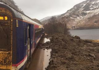 Train trapped in landslide