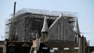 The rosette of the Notre-Dame de Paris Cathedral in Paris on April 22, 2019 is covered with protective material seven days after a fire in the cathedral.