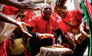 Supporters of the Zimbabwe opposition party Movement for Democratic Change (MDC) sing and play funeral drums outside the party's headquarters, in Harare following the death of veteran opposition leader Morgan Tsvangirai - 15 February 2018
