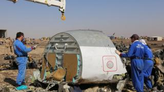 Russian personnel at site of plane wreckage