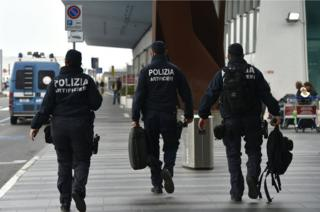 Italian police officers patrol at Rome's Fiumicino aiport on March 22, 2016.