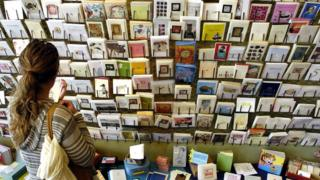 A woman choosing a Mother's Day card