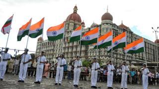 Navy cadets take part in a rehearsal infront of the Taj Mahal hotel in Mumbai on November 24, 2010.