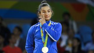 Gold medallist Majlinda Kelmendi of Kosovo waves to the crowd in Rio