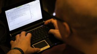 A participant looks at lines of code on a laptop on the first day of the 28th Chaos Communication Congress (28C3) - Behind Enemy Lines computer hacker conference on December 27, 2011 in Berlin, Germany.
