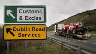 A lorry passing road signs near the Irish border
