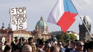 Demonstrators marching during an anti-immigrants rally in Prague, Czech Republic, September 12, 2015.