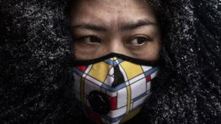 environment Chinese woman in a protective mask