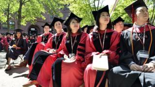Harvard University students at graduation.