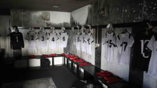 Clach FC shirts hanging in the fire damaged changing room