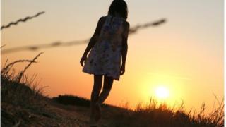 Anonymous girl walking away