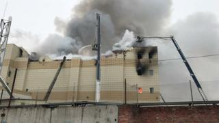 Firefighters extinguish a fire at a shopping mall in Kemerovo, Russia March 25, 2018