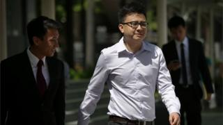 "Yang Kaiheng, 27, co-founder of ""The Real Singapore"" website, right, arrives with his lawyer Choo Zheng Xi, left, at the State Court on Tuesday, June 28, 2016, in Singapore."