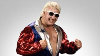 Johnny Valiant, seen here in sunglasses and a sparkly jacket