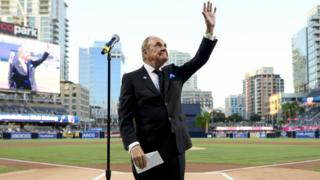 Dick Enberg waves to the crowd during a ceremony held before a baseball game between the San Diego Padres and the Los Angeles Dodgers, 29 September 2016