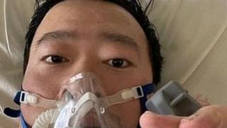Dr Li posts a picture of himself in a gas mask from his hospital bed