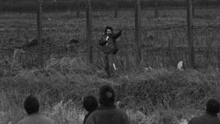 Michael Stone shoots towards mourners at Milltown Cemetery