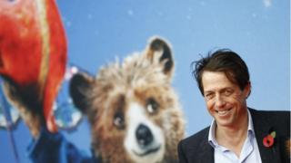 Paddington film poster and Hugh Grant