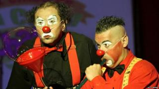 Clowns perform at El Circo de la Chola Chabuca, Sunday, July 19, 2009, in Lima, Peru