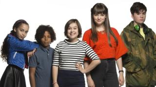 Mya-Lecia Naylor with the cast of Millie Inbetween