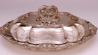 Silver entrée dish presented to Thomas Cole. Object lent by Charles Stuart Dudley Cole