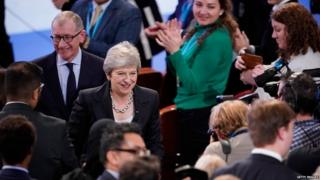 Theresa May leaves the stage at the end of her conference speech