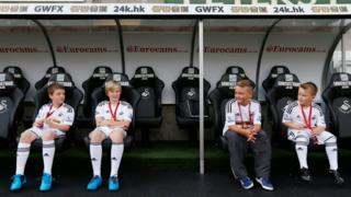 Swansea City mascots in dug-out
