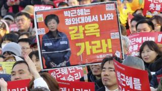 Anti-Park protesters in Seoul, 11 March. The sign reads Go to prison