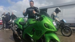 Zef Eisenberg standing behind his bike