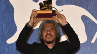 Filipino film maker Lav Diaz holds the Golden Lion award for his movie The Woman Who Left during the Venice International Film Festival