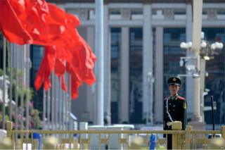 A paramilitary policeman stands at attention in Tiananmen Square in Beijing on 2 September 2015.