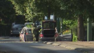 A Belgian bomb squad check the vehicle in which two suspects were found with explosives
