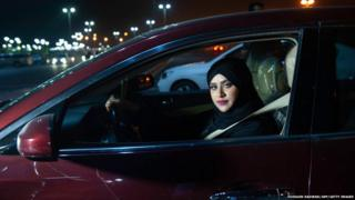 Saudi woman Sabika Habib drives her car through the streets of Khobar City on her way to Kingdom of Bahrain. For the first time little after midnight the law allow women to drive on June 24, 2018.