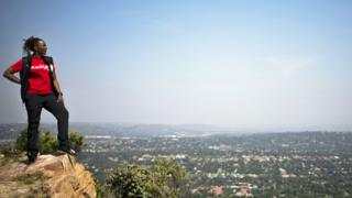 Mountain climber, Saray Khumalo at the top of a hill overlooking Johannesburg, South Africa - Thursday 30 January 2020