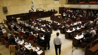 Israeli lawmakers vote on the controversial Police Recommendations Bill in the Knesset on 27 December 2017