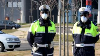 Police on guard at the hospital of Schiavonia, near Padova, where tests for the coronavirus are performed in Veneto region