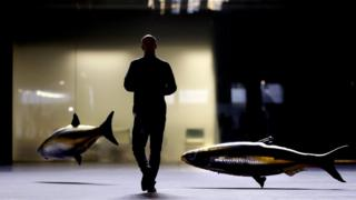 French artist Philippe Parreno with his floating fish in the Turbine Hall at Tate Modern