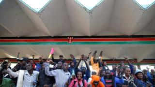 Supporters cheer as they wait for Kenyan opposition leader Raila Odinga at Uhuru Park in Nairobi on 30 January 2018