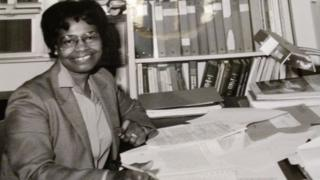 Gladys West at her office desk
