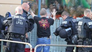 Police searching a neo-Nazi ahead of a concert in the German town of Apolda (6 October)